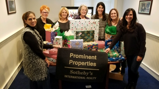 Prominent Properties Sotheby's International Realty volunteers with 'All Wrapped Up,' a holiday giving program, for the 3rd consecutive year